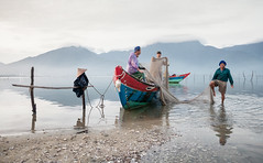 Fishermen of Lan Co (Asian Hideaways Photography) Tags: laguna langco vietnam vietnamese fisherman boat water lagoon mountains morning