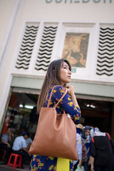 Young Vietnamese woman in Ao Dai visiting market (Apricot Cafe) Tags: img105681 aodai asia asianandindianethnicities benthanhmarket hochiminhcity millennialgeneration tamronsp35mmf18divcusdmodelf012 vietnam vietnameseethnicity vietnameseculture bag carefree citylife colorimage cultures day happiness lifestyles longhair lookingaway market oneperson oneyoungwomanonly outdoors people photography portrait realpeople rearview serenepeople shopping smiling store straighthair threequarterlength tourism tourist tradition traditionalclothing travel visiting women youngadult hochiminh vn