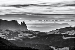 The holy Mountain and the distant Ones... (Ody on the mount) Tags: anlässe berge dolomiten em5ii fototour himmel mzuiko6028 omd olympus schlern seiseralm südtirol urlaub wolken bw clouds monochrome mountains sw sky selvadivalgardena trentinoaltoadige italien it