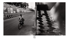 Relate (krishartsphotography) Tags: krishnansrinivasan krishnan srinivasan krish arts photography monochrome fineart fine art stairs shadow dark light natural shape triangle zig zag steps bridge subway cycle bicycle road rails median mural blur motion speed perspective diminishing affinity photo palakkarai trichy tamilnadu india