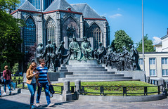 2018 - Belgium - Gent - Hubert et Jan van Eyck Monument (Ted's photos - For Me & You) Tags: 2018 belgium cropped ghent nikon nikond750 nikonfx tedmcgrath tedsphotos vignetting hubertetjanvaneyckmonument hubertetjanvaneyckmonumentghent ghentbelgium streetscene street people peopleandpaths pathsandpeople railing bronzesculpture bronze valentinvaerwyck valentinvaerwyckghent hubertvaneyck hubertvaneyckghent janvaneyck janvaneyckghent denim denimjeans handbag jozefcasier jozefcasierghent church arches bollard shadow shadows monument