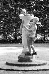 Sibling sculpture (rosberond) Tags: children boy girl siblings blackandwhite bw canonefs1785mmf456isusm playing sculpture outdoors
