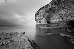 North Landing Caves (AndyNeal) Tags: landscape seascape cliffs water sky beach blackandwhite monochrome longexposure neutraldensityfilter movement cloudmovement watermovement milkywater milkysea flamborough northlanding caves sea