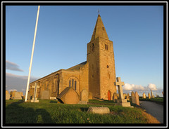 Newbiggin By-The-Sea. Northumberland (M E For Bees (Was Margaret Edge The Bee Girl)) Tags: northumberland newbigginbythesea church canon christianity tower spire blue sky sun summer outdoors town evening stone old building churchofengland churchyard gravestones flagpole windows green grass