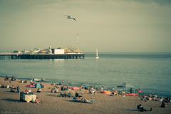 Beached... (Anthony P.26) Tags: brighton brightonpier category eastsussex england places seascape travel sailboat boat bird seagull beach sea sky pier building pleasurepier uk english theenglishchannel water sunbathing tourism canon1585mm canon canon70d outdoor pebblebeach sunlounger parasol summer