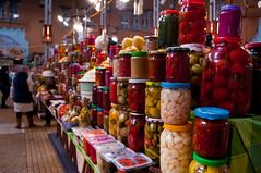 Counters in the Bessarabian market, Kiev, Ukraine (iliya.hazan) Tags: ukraine kiev hall shopping market bessarabskymarket bessarabsky counter food people condiments driedfruit shop tomatoes garlic banks