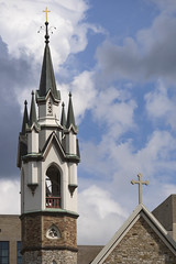 St. Mark's Episcopal Church (DJ Wolfman) Tags: church steeple cross stmarks episcopal grandrapids grandrapidsmi michigan architecture white blue sky clouds brick olympus olympusomd em1markii omd panasonic panasonic35100f28 micro43