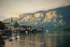 Sunny Hallstatt (DrQ_Emilian) Tags: laandscape view mountains alps cliffs town village buildings architecture lake water clouds sunlight light colors details outdoors reflection nature evening mood moody travel visit explore discover destination hallstatt hallstattersee salzburg salzburgerland austria europe photography hobby