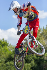 Flight (Kyle William Russell) Tags: helmet white rider rubber tire silver redline forks pegs moline illinois cup gold adidas air jump speed pedal sports sport jersey blue red racing race stunt bicycle bike bmx