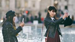 Copycats (Stuart Mac) Tags: selfie candid hat street women asian winter d700 135mm