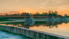 evening vibes 2 (karwinho) Tags: river odra wroclaw opatowice jaz weir tree reflection mirror landscape clouds sky nature beauty water grass evening poland vibe spot outdoor sunset light opatovice chillout relax color contrail wroclove bridge plane aircraft streak oder orange line