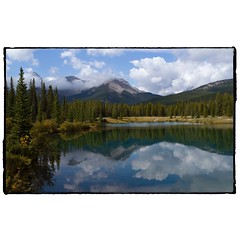 Forget Me Not Pond mountain reflection. #photography #photooftheday #photoadaychallenge #canon7d #canon2470 #mountains #reflection #sky #clouds #travelalberta #project365 #kananaskiscountry