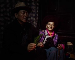 Mosuo G/mother, Matriarchal Society (Rod Waddington) Tags: china chinese yunnan mosuo minority ethnic ethnicity culture cultural matriarch matriarchal society matrilineal matriarchies female ceremony portrait people blessing buddhist buddhism religious religion eastern indoor house grandmother head