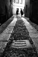 Manhole covers and people (Leica M6) (stefankamert) Tags: stefankamert street manholecover schachtdeckel lines film analog grain bokeh dof people blur blurry leica m6 leicam6 kodak trix summitar noir blackandwhite blackwhite bellagio