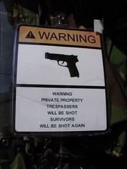 Trigger Happy (Glass Horse 2017) Tags: triggerhappy nyorks whitby shop window sign warning gun signsunday tommyguns armysurplus