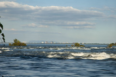 across the river (Lou Musacchio) Tags: landscape waterscape urbanscenic water horizon clouds sky parcdesrapides villelasalle montreal quebec canada