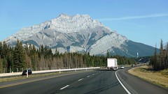 Trans-Canada Highway (AB- 1) between Canmore and Banff (lhboudreau) Tags: transcanadahighway highway canada alberta hwy1 highway1 road car cars automobile automobiles route1 route truck mountain tree roadway roadside trees pine pines pinetree pinetrees sky street forest
