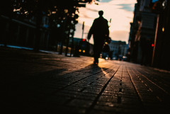 forward looking back (ewitsoe) Tags: auutmn fall poznan nikon street urban morning dawn silhouette city poland polsak ewitsoe cityscape shadows dark sunrise sun sidewalk looming person