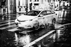driving through water (ale_brando) Tags: rain night puddle taxi spray streetlights lights rome romebynight roma nikonfx fx