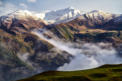 Caucasus: Stillness and Gravity. (icarium.imagery) Tags: canoneos7d canonefs18135mmf3556is travel captureone caucasus clouds fog georgia highaltitude landscape mountainrange mountains peaks valley vibrant snow snowcapped tusheti