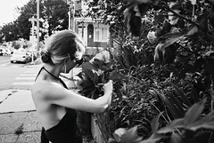R3-071-34 (David Swift Photography) Tags: davidswiftphotography philadelphia westphiladelphia gardens women monochrome flowers plants 35mm candidphotos nikonfm2 ilfordxp2