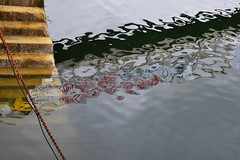 dockside (Jeanne Menjoulet) Tags: concarneau dockside stairs escaliers port reflection reflets chaîne chain abstract abstrait water eau