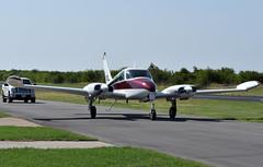 Cessna 310J (DPhelps) Tags: t67 hicks airfield saturday beacon cafe airside general aviation plane airplane spotting panning prop blur avgeek twin cessna c310 310 c310j n3111l 1965 truck traffic car
