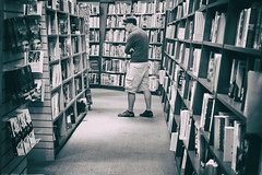 Bookworm on the Loose (flashfix) Tags: september022018 2018inphotos flashfix flashfixphotography ottawa ontario canada nikond7100 40mm portrait male man chapters books novels fiction choices selection shelves store shopping monochrome blackandwhite dailylife candidportrait candid