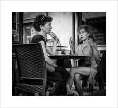 Bar conversation (tkimages2011) Tags: bar people woman dialogue animated gestures table cups provence sanremy mono monochrome street streetlife chair