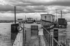 Walk the Plank (merseamillsy) Tags: stormyskies water walkway mersea sea hightide houseboats tide stormy coastal planks sky seascape coastline coast merseaisland clouds
