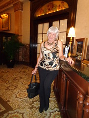 Checking In (Laurette Victoria) Tags: hotel lobby milwaukee pfisterhotel woman laurette lady pants silver necklace animalprint