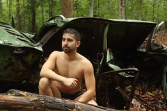 Sheltered (seventh_sense) Tags: forest woods outdoor outdoors rain rainy afternoon nude model male man figure car automobile abandoned deserted derelict rust metal rusted rusty weathered bare portrait study tree trees leaf leaves summer hike nature natural jake