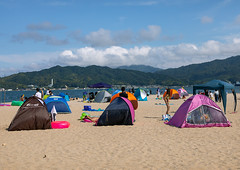 Sunshade beach tens on the beach along the sandbar in Amanohashidate, Kyoto Prefecture, Miyazu, Japan (Eric Lafforgue) Tags: adults amanohashidate asia beach beautyinnature children colorimage copyspace day destination groupofpeople holidays horizontal idyllic japan japan18259 landscape men miyazubay nature outdoors pacificocean sand sandbar scenic scenics sea summer sunshadebeachtent tourism tranquilscene travel traveldestinations tropicalclimate vacations water women miyazu kyotoprefecture jp