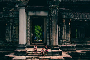 Locals playing in front of the temple ruins
