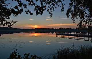 Sunset on the lake. Warm autumn in Finland.