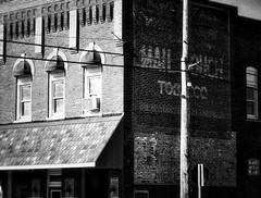 Smalltown Indiana (RandallMcRoberts) Tags: artphotography bw blackandwhite brick brickbuilding fineartphotography monochrome paintedbrick smalltown