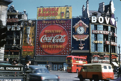 Picadilly Circus (jericl cat) Tags: picadilly circus july 1959 neon sign double diamond everready batteries coca cola animated guinness time clock schwepps tonic longiness decker bus policeman chinese restaurant westminster bank spectacular signs fortes