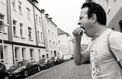 Hungry or tired? (Guido Klumpe) Tags: mann men funny hungry tired leonegraph streetphotographer streetphotography candid unposed street germany deutschland city stadt monochrome bw blanco negro bn sw schwarz weis panasonicgx80 mft hannover