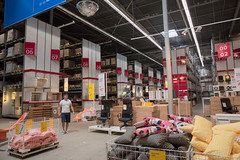 Inside IKEA at Haarlem, Sparnwoude (natures-pencil) Tags: ikea haarlem sparnwoude nederland netherlands buildingarchitecture interior shopping design style warehouse racking packaging furniture decor cushions chairs man person figure signs reflections lighting