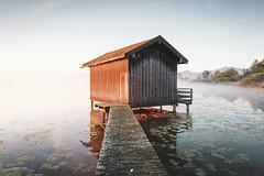 Chiemsee, Bavaria (Sunny Herzinger) Tags: chiemsee dedeutschland sunrise refelction europa alps mist moody lake bayern alpen herkunft fujixpro2 chiemgau house bavaria fog cottage rimsting germany de jetty