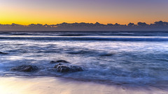 Sunrise by the Sea (Merrillie) Tags: australia blueskies bluesky centralcoast coast coastal dawn daybreak earlymorning landscape macmasters macmastersbeach morning nature newsouthwales nsw ocean outdoors rocks scenic sea seascape seaside sky sunrise water waterscape waves