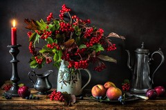 Autumn's Abundance (memoryweaver) Tags: tabletop textured candlestick candlelight candle pewter peaches mug stilllife memoryweaver viburnum guelderrose berries fall autumn