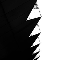 On The Edge (YIP2) Tags: minimal minimalism simple line lines detail details pattern curves abstract surface less urbandetail square carre city urban stripes linea geometry design outside building wall construction architecture repetition contrast lightshadow shadow window light rhythm accidental bw blackandwhite monochrome