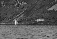 Scotland West Highlands Kintyre Holy Island the lighthouse at Kingscross Point and cottages 1 July 2018 by Anne MacKay (Anne MacKay images of interest & wonder) Tags: scotland west highlands kintyre holy island lighthouse kingscross point cottage cottages house houses sea cliff monochrome blackandwhite mountain landscape 1 july 2018 picture by anne mackay
