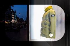 coat (Gerrit-Jan Visser) Tags: new coat shop window darkness light amsterdam contrast opposition