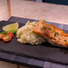 Salmon Filet with mashed potatoes, tomatos and lime served stone serving plate
