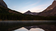 Dawn at Fishercap Lake ((JAndersen)) Tags: fishercaplake water reflection glacier glaciernationalpark sunrise mountains mist montana usa nikon d810 nikkor2470mmf28ged