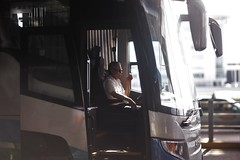 It's All Cool ! (N A Y E E M) Tags: driver bus candid cigarette smoke light afternoon street airport pudong shanghai china