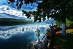 Secret Garden (Alfred Grupstra) Tags: lake nature mountain water landscape outdoors scenics tranquilscene sky beautyinnature summer reflection mountainrange tree relaxation greencolor nopeople blue travel cloudsky