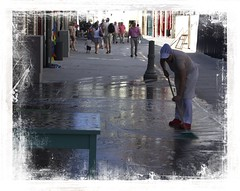 Mopping up (Audrey A Jackson) Tags: canon60d portugal shop water cleaning table man